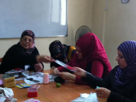 Mme Fatima El Khatib trainer is distributing the material to the beneficiaries