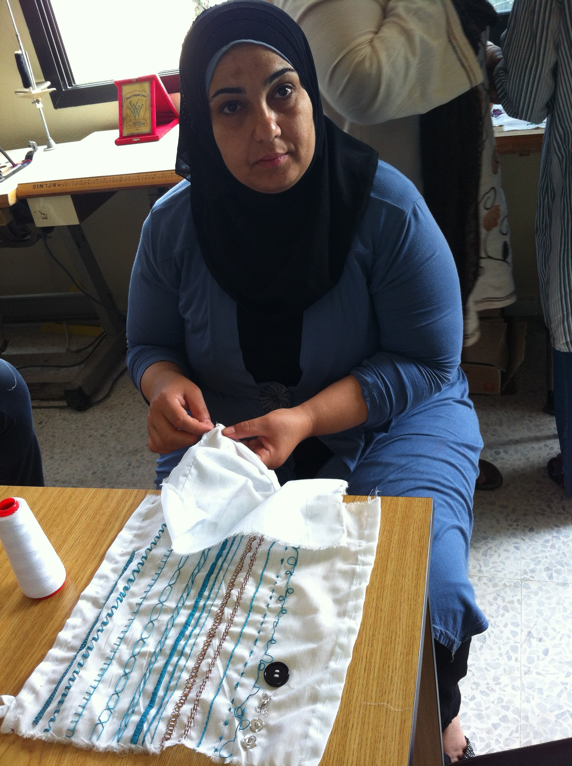 Mme Tamam Khaled Jammal - 38 years old - Living in Bourj Al Chamali Camp -She's a mother of 3 children - She loves broidery but it's the first time that she take it as a job