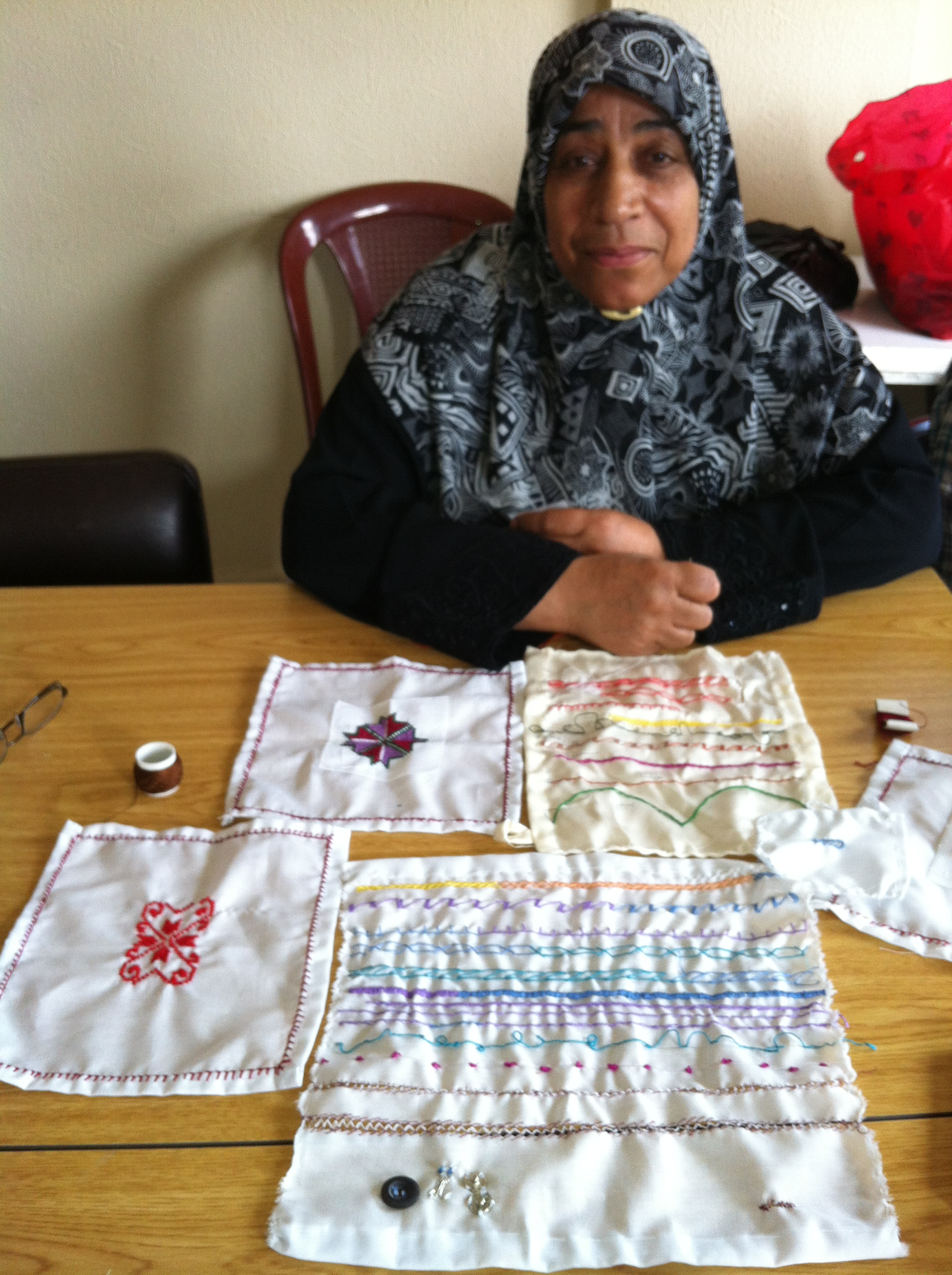 Bour Al Chamali Camp/ Mme Abla Ibrahim - 38years old a widowed women that is enjoying her first experience in broidery and is so exited to start building her job in Tatreez cooperative